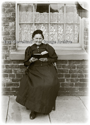 Elderly Lady with Book